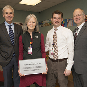 Patricia O'Malley, MD, (center) with hospital leaders, (from left) Ronald Kleinman,MD, physician-in-chief of MGHfC; Ari Cohen, MD, chief, division of Pediatric Emergency Medicine, and David Brown, MD, chief of the Department of Emergency Medicine.