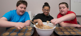 From left, Aidan Colwell, Rana Ahmed and Stephen Graves make bran muffins at a Youth Zone kids cooking class.