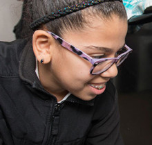 Rana Ahmed checks on the healthy muffins she and her classmates are making during a cooking class at Youth Zone, an afterschool program of MGH Revere Health Center.