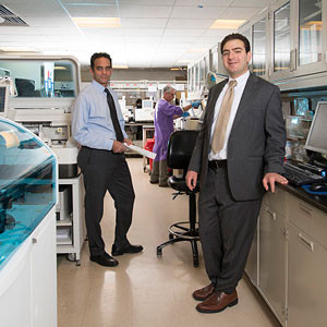 Drs. Dighe and Baron use the power of computers to analyze patterns found in pathology lab results and other patient information.
