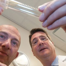 Mehmet Toner, PhD, director of the BioMicroElectromechanical Systems (BioMEMS) Resource Center, and Thomas Toth, MD, director of the Vincent IVF Unit show off the tiny straw-like device that cools eggs about 100 times faster than the blink of an eye.