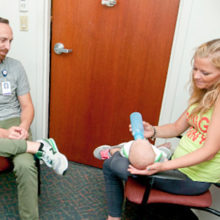 Recovery coach Michael Phillips meets with patient Shannon Donnelly in Everett