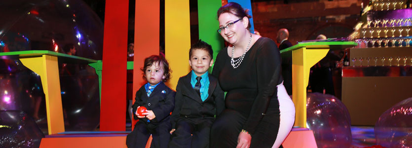 At the Storybook Ball, pediatrician Rebecca Cronin, MD, posed with her patients Daniel Ortiz Cisneros, 2 (left), and his brother Alex, 4, of Chelsea.