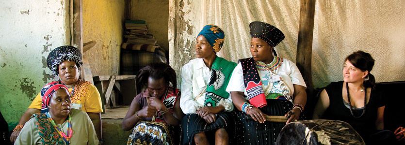 Krista Dong, MD (far right), with traditional healers in Africa working to identify HIV infection early.