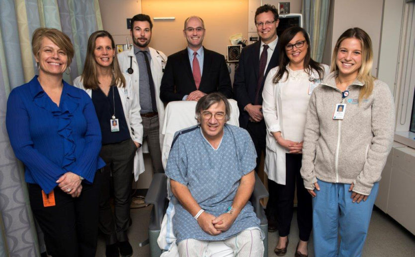 Kevin Daignault (center) with members of his heart transplantcare team including, from left, Janice Camuso, RN; Karen Turvey, CNP; Johannes Steiner, MD; David D'Alessandro, MD; Greg Lewis, MD; Kerry Gaj, NP; and Katie Stettner, PA.