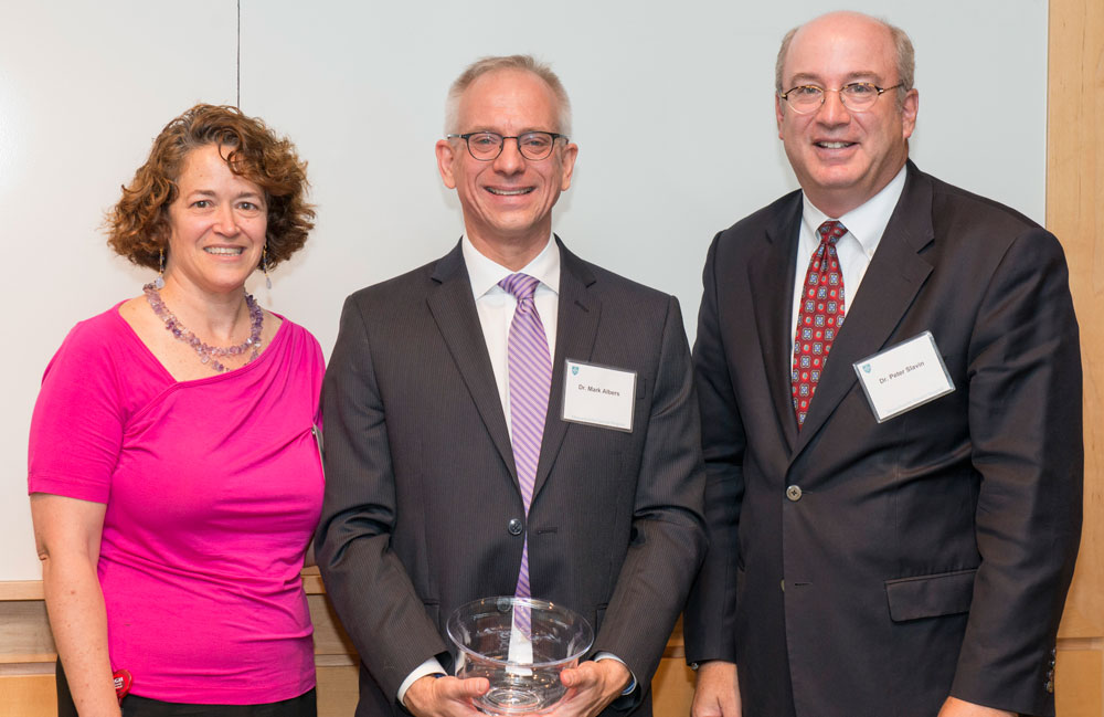 Through a transformational gift from Maureen Wilkens and the Wilkens Family, Mark Albers (center), MD, PhD, was recently appointed the inaugural incumbent of the Frank Wilkens, Jr. and Family Endowed Chair in Alzheimer's Disease Research. Pictured with Merit Cudkowicz (left), MD and Peter Slavin (right), MD.