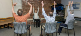 Laura Malloy of the Benson-Henry Institute teaches chair yoga for stress management.